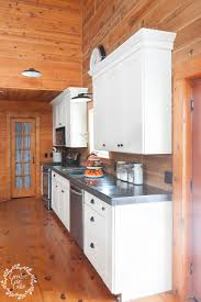 black kitchen cabinets in log cabin kitchen organization with pantry storage jars creative