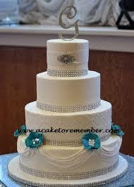 wedding cake jewelry teal flowers and sugar jewels wedding cake