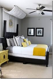yellow and grey room drape a curtain over the top of the bed thinking the sheer