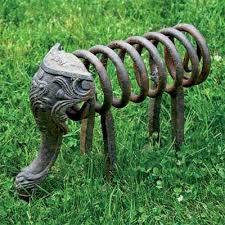 turn salvaged junk into garden ornaments yard sculptures metal