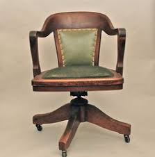 wood desk chair with wheels antique bankers oak rolling desk chair 1920s wood casters library