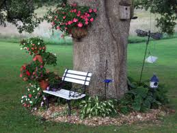 idea for the front flowers around the tree house pinterest