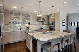 white island cabinet and bar stools kitchen skylights medium