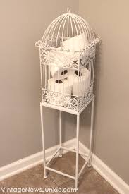 love the idea as a birdcage for a toilet paper holder in the