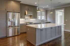 medium gray cabinets with white countertop and dark floor