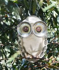 robyn stewardson owl garden ornaments from recycled kitchenware