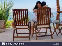 Teak Deck Chairs Romantic Couple Cuddles In A Teak Deck Chair While Enjoying Their