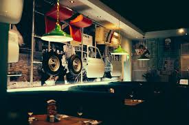 bella italia dudley for example a wall of the original fiat 500 components is hung from a scaffold frame in front of a vintage photography digital mural