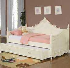 white wooden carving daybed with storage and pink bed cover on the