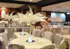Cheap Centerpieces Cheap Centerpieces With White Feathers In Tall Glass Vases Jpg