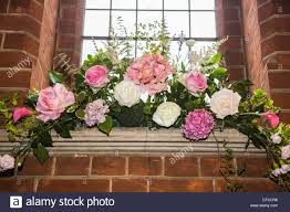 Peony Floral Arrangement by Flower Arrangement Floral Display With White Peonies And Green