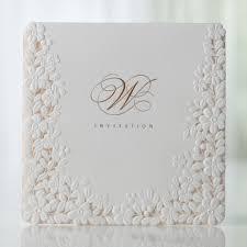 embossed wedding invitations ivory pink embossed laser cut floral wedding invitations bh 3301