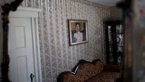7 haunted houses you can stay in but will you sleep a wink a portrait of lizzie borden on the wall inside the front parlor room of her house