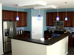 kitchen paint colors with cherry cabinets and stainless steel appliances two toned kitchen with cherry cabinets and blue wall