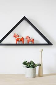repurpose a flag display case as a triangle shelf hello lidy