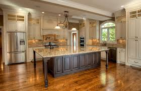 dark wood floors with light cabinets create a cart white kitchen