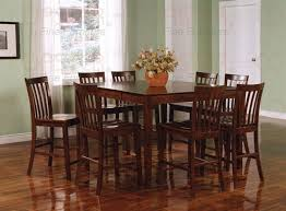 9 piece counter height table set in rich walnut finish by coaster