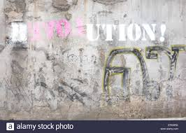 revolution love graffiti logo on textured wall stock photo