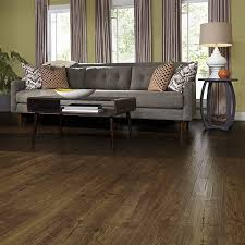 auburn scraped oak laminate floor with wear and spill