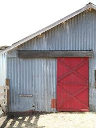 corrugated barn with red painted barn door gardenista the salad