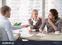 bank consultant trying convince clients get stock photo 582569929