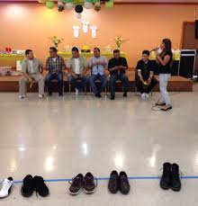 co ed baby shower game have the men take off their shoes and