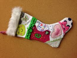 christmas stocking made from clothes from babies 1st year