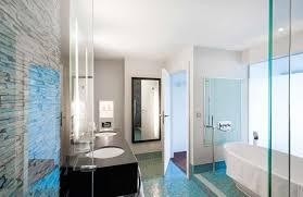 luxury bathroom with double undermount sinks and freestanding tub