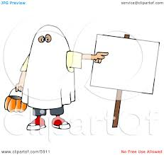 boy wearing a halloween ghost costume while pointing at a blank