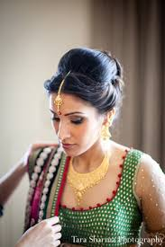 indian wedding bride getting ready hair makeup in princeton nj indian wedding by tara sharma photography