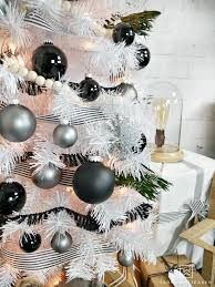 creates this modern black and white tree display in