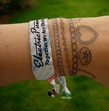 bracelet tattoo with kids names inside of wrist callie hand font
