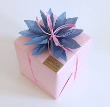 paper gift bows make this raffia flower gift bow