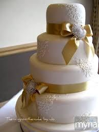 wedding cake gold gold and brooch wedding cake myria