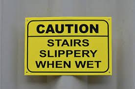 caution stairs slippery when wet yellow hazard danger warning sign