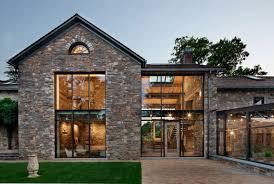 exteriors volumetric house with brown brick wall exterior design