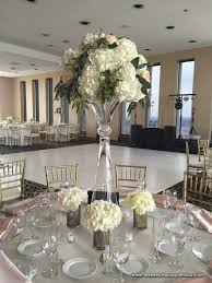 White Roses Centerpieces by Tall White Hydrangea And Rose Centerpiece In Glass Trumpet Vase