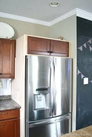 adding cabinets on top of existing cabinets adding kitchen cabinets above existing cabinets building in fridge
