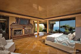 contemporary master bedroom with fireplace travertine tile
