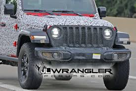 charcoal grey jeep rubicon 2018 jeep wrangler jl drops major camo revealing nearly all