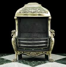 a very striking large brass hooded fire basket in the renaissance