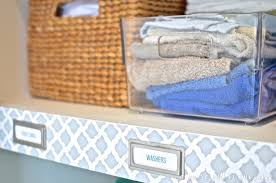 how to organise your linen cupboard and a pretty linen cupboard