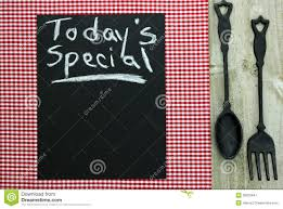 chalkboard with today u0027s special and cast iron spoon and fork stock