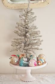 decorating idea to put a mini tree on a pedestal