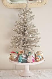 christmas decorating cute idea to put a mini tree on a pedestal