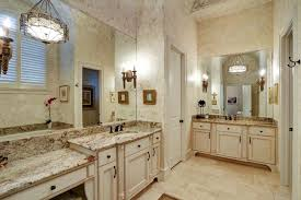 This Spacious Master Bathroom Features Two Separate Vanity Spaces - White cabinets master bathroom