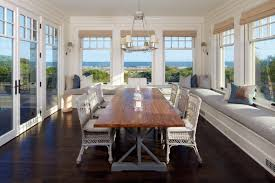 airy dining room with a long wall bench and views of the beach in