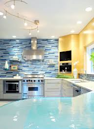 modish white cabinets set with blue mosaic wall tile backsplash as
