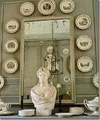 and antique plates hang on boiserie instead of fine oil paintings