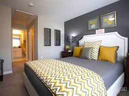 apartment bedroom ideas we this yellow gray palette in this bedroom yellow